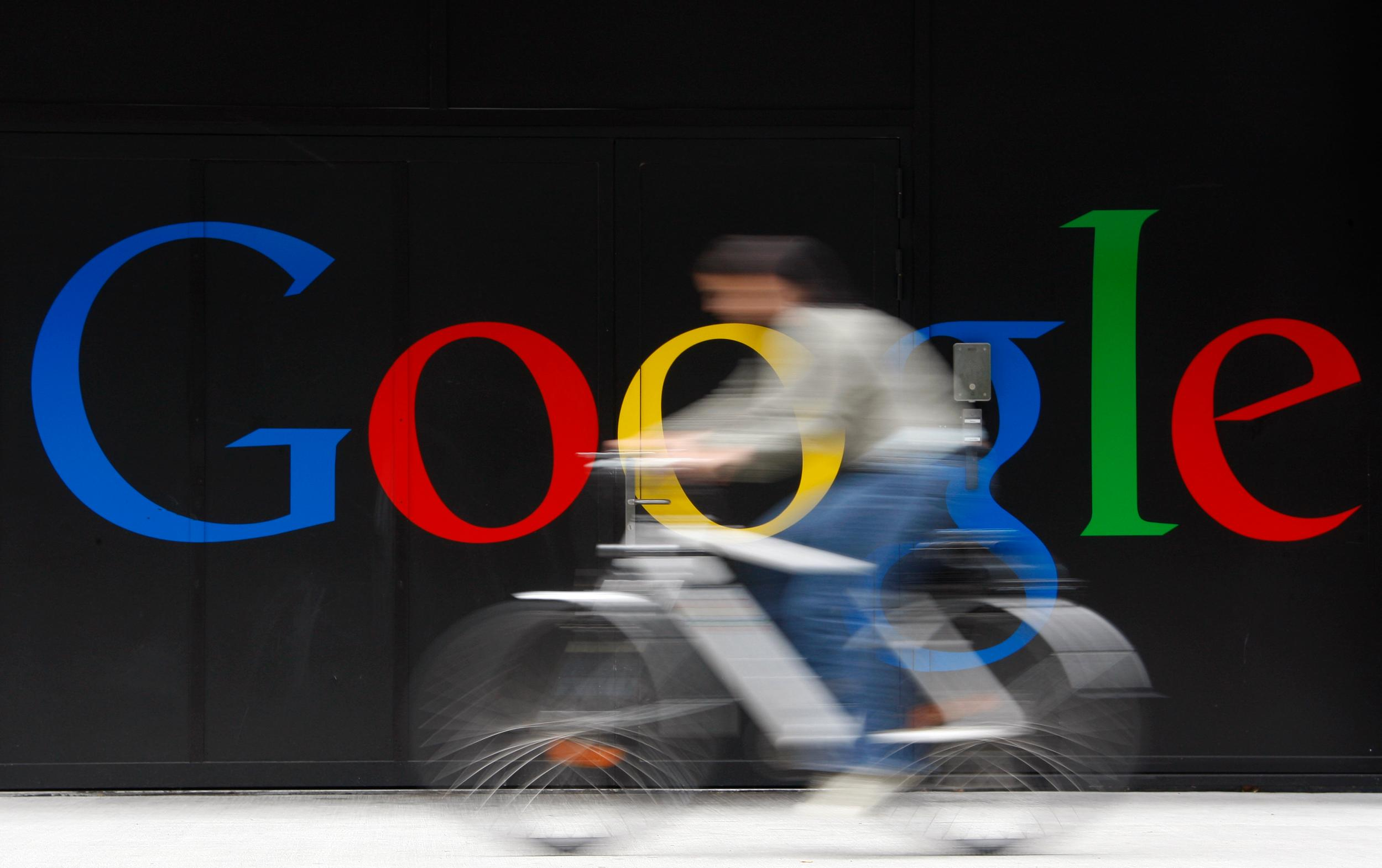 Commuter-on-a-bicycle-in-front-of-a-Google-sign.jpg