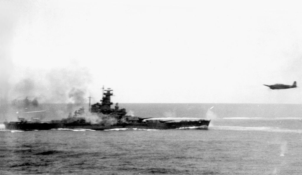 Japanese_Nakajima_B5N2_flies_near_USS_South_Dakota_(BB-57)_during_the_Battle_of_the_Santa_Cruz_Islands_on_26_October_1942_(80-G-30054).jpg