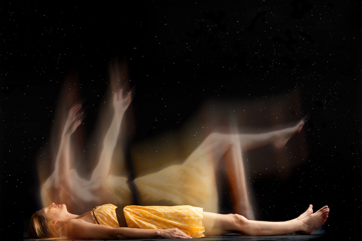 a woman in a yellow dress appears to leaving her own body