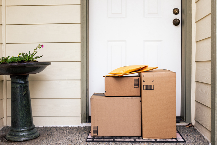 a large stack of packages at a front door