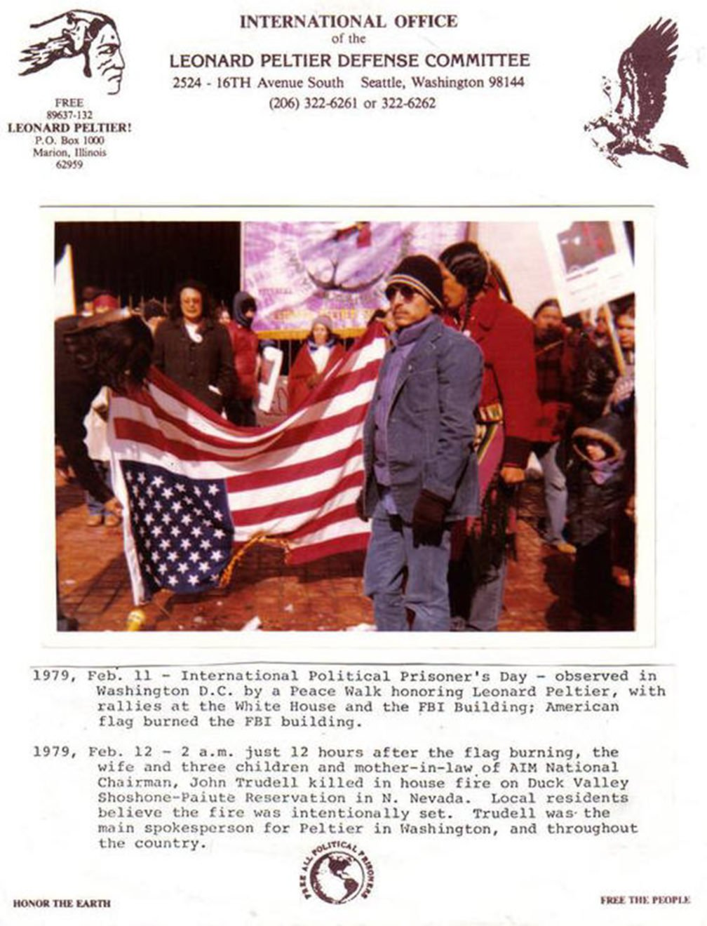 a group of people burning an american flag