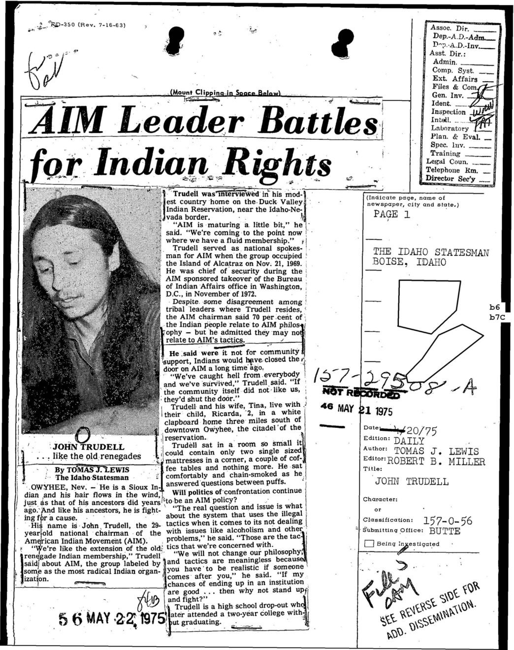 an old newspaper clipping showing a picture of a man with long dark hair