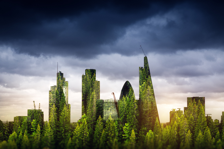 a cityscape where all the buildings are covered in greenery