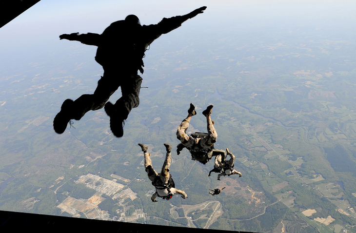 people jumping out of an airplane
