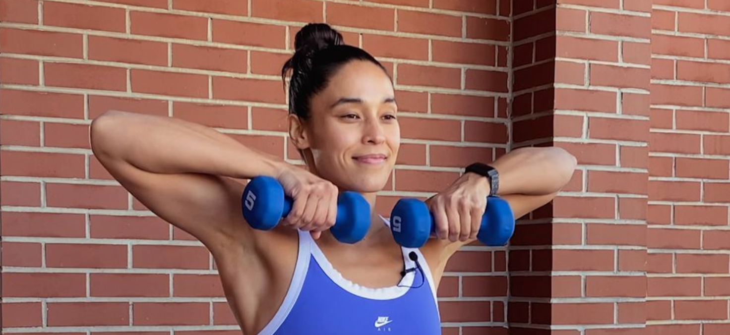 person holding weights to their chin with their elbows straight out