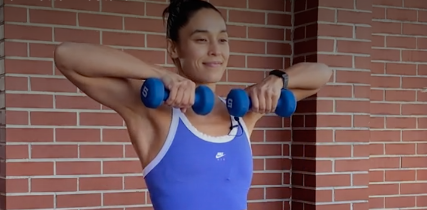 person pulling elbows up and out wide to lift the dumbbells to chest