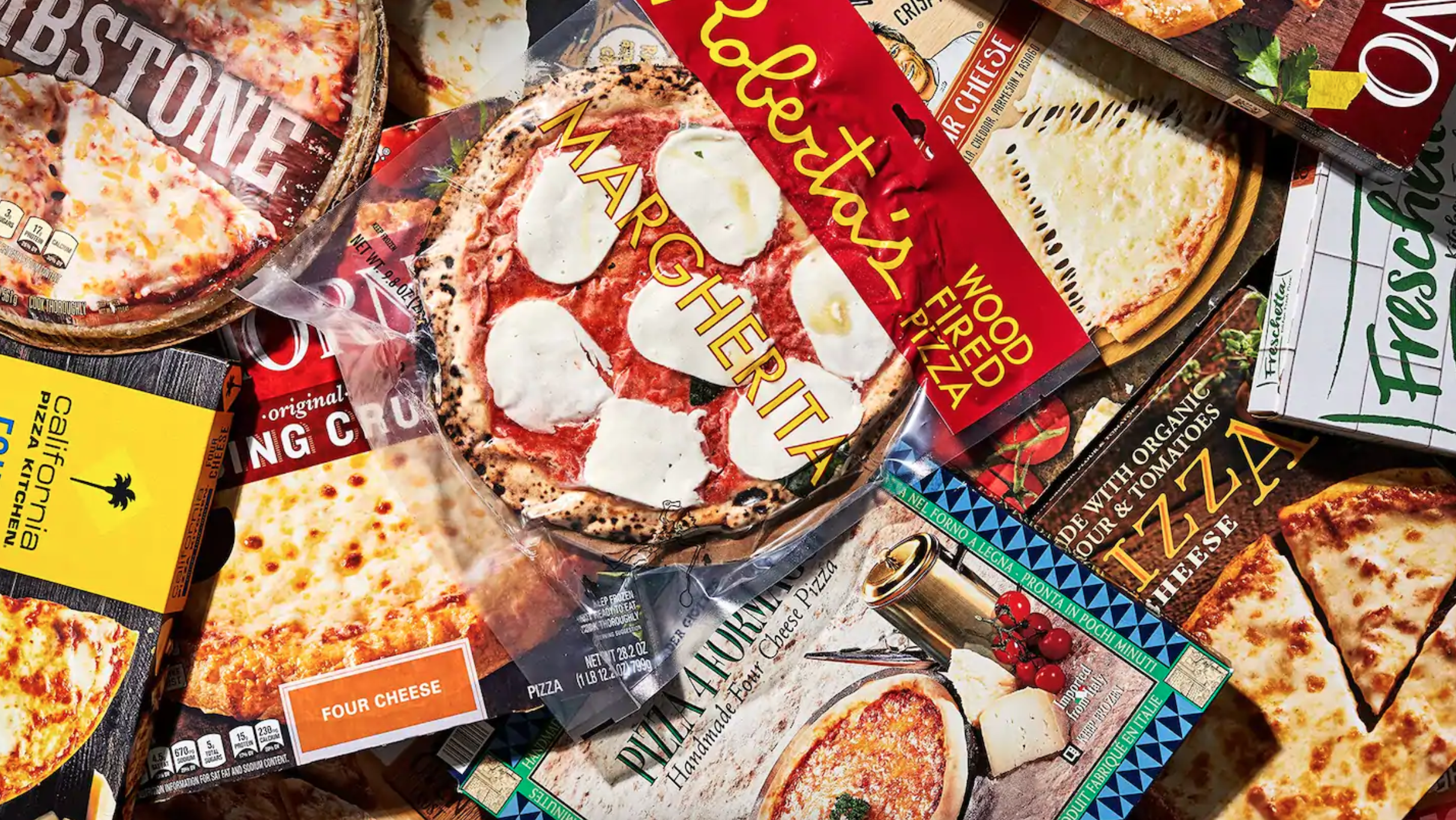 a pile of frozen pizzas from different brands