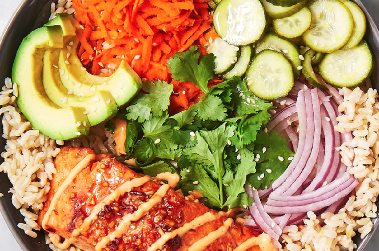bowl of grains and fish and veggies